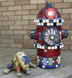 Spot and his Puppy Porto Potty by Moe's Ache, via Flickr  (there are MANY mosaic dogs on this page!)