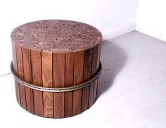 Recycled stool made from wood scraps held together by old bike wheel
