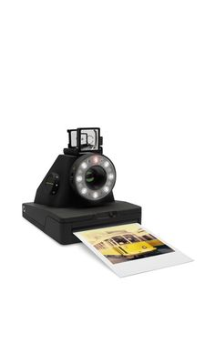 15 Holiday Gifts for Him | Impossible Project Polaroid Camera | A classic point-and-shoot instant camera — only, this one comes with an exposure tool, allows you to experiment with creative lighting, and looks beyond rad.