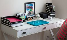 Carve out a little work space in your bedroom by mixing the accessories you have in your room. This little workspace could double as a nightstand!