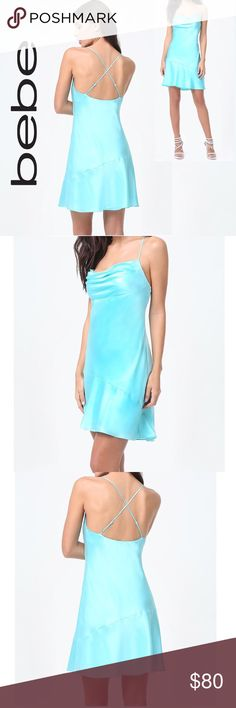 """Bebe Silk Dress Stunning slip dress in a luxurious silk charmeuse. Crisscross back; flirty   Uploading additional pictures later today.  * 100% Silk * Color: Turquoise Blue  * Dry clean * Adjustable Criss Cross Back Straps * Fully lined Aruba Blue * Pullover; No closures * Center back to hem: 23"""" (58.5 cm) * Model is 5'8"""" and wears a US size 6  *Price is firm, unless bundled for additional discount. bebe Dresses Mini"""