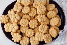 Cytrynowe ciastka z maszynki wyciskane. Ciasteczka są kruche, delikatne i wręcz rozpływają się w ustach.