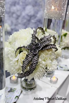 LOVE this succulent! It looks like a giant spider - perfect for the bride who loves black! #wedding #bouquet