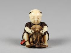 Netsuke of Boy Playing with a Dog, 19th century. Japanese. The Metropolitan…