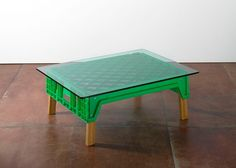 Michael Marriot coffee table  using plastic bread crate, oak legs & green glass top