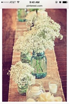 Mason jar themed centerpiece.  Lace and checked fabric or hessian