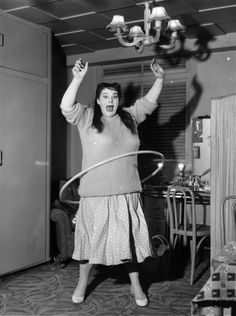 One way to get moving and shaking in 1958 — hula hooping as demonstrated by Hula Hattie.   20 Redonk Ways People Worked Out In The OldenDays