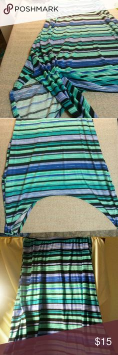 Joe b hi lo maxi skirt Beautiful watercolor hi lo maxi. Longest on the sides is 34in top to bottom is 28 in. Elastic waistband measurements and 12 1/2 in. Color s are beautiful sea green royal blue black white lilac turquoise chartreuse Joe b Skirts Maxi