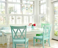 Breakfast Nook - plantation shutters, white farmhouse table, chairs painted an accent color