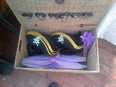 Pirate hats and eye patches for Pirates, pink and purple wings and home made wands for the fairies