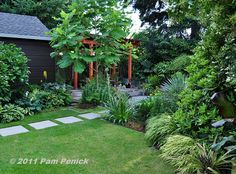 Use angles in the garden, instead just following the yard's boundaries...  front side yard.  Foliage fantasia in Portland's Danger Garden | Digging