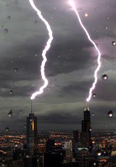 Lightning strikes both Trump Tower & John Hancock Center at the same time. Chicago - June 23, 2010