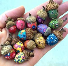 Created by Bull's Eye Studio. Polymer clay acorns.