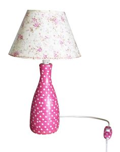 Decoupaged lamp (base, shade and switch button) using pretty Decopatch papers.