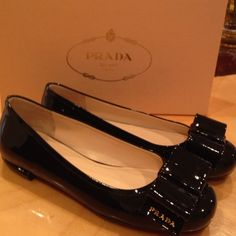 Prada flat shoes size 36 1/2 Brand new in box , patent leather . Very small heel , elegant with bow on top and Prada logo on side of each bow Prada Shoes Flats & Loafers