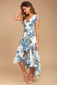 Take a jaunt through the gardens with the French Countryside White Floral Print High-Low Dress! Floral print high-low dress with a surplice bodice and cute cap sleeves.