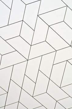 Geometric white tile pattern (grey grout) using diamond / rhombus and trapezoid / trapezium shapes: