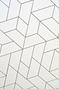 Geometric white tile pattern (grey grout) using diamond / rhombus and trapezoid / trapezium shapes: