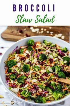 This healthy Broccoli Slaw Salad has a delicious no-mayo dressing that uses Greek Yogurt. With almonds and dried cranberries, this crunchy salad is packed with flavor. Healthy Side Dishes, Easy Healthy Dinners, Healthy Dinner Recipes, Vegan Dishes, Vegetarian Greek Recipes, Vegan Recipes, Yummy Recipes, Broccoli Slaw Salad, Broccoli Slaw Recipes