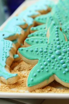 Can I tempt you with some aquatic cookies? I made this set of cookies for a teacher appreciation event at my sister's school. Since I get so many questions about how I decorate my cookies, I … Galletas Cookies, Iced Cookies, Royal Icing Cookies, Cupcake Cookies, Cookies Et Biscuits, Star Cookies, Starfish Cookies, Mermaid Cookies, Cake Pops