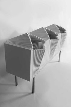 The Wave by Sebastian Errazuriz. The cabinet can be completely closed up, or in a variety of open stages and configurations.
