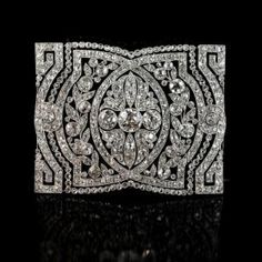 Beautiful Belle-Epoque articulated collar-piece of rectangular form with three central old-European cut diamonds within an openwork panel of...
