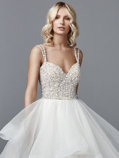 Sottero and Midgley - MICAH, This princess wedding dress features a bead and Swarovski crystal-encrusted bodice atop a tiered ballgown skirt of tulle and horsehair. Double spaghetti straps glide from the V-neck into a crisscross pattern over the scoop back. Finished with crystal buttons over zipper closure. Detachable beaded belt sold separately.