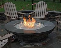 Wooden Sun offers a wide variety of #firepit rings, burner pans, and decorative rock or glass media.  Indoors, these pan burners can replace gas logs in a masonry fireplace for an instant artistic re-design; outdoors, American Fire Glass burners can sit in your firepit or tabletop firepot for a unique patio accent. #Firepits #fireplaces #exteriordecor #patiodecor