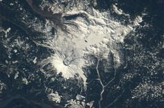 "Astronaut Tom Marshburn captured this picture of Mt. St. Helens from the International Space Station on 3-13-13. In his words: ""St. Helens shining in a cover of snow - signature of the eruption 33 years ago still evident."" #Earth  #Space  #ISS  #Geology  #Astronaut  #InternationalSpaceStation  #NASA  #Orbit  #Photography  #Science  #CrewEarthObs"