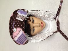 Cupcake bomber hat with fluffy white on the inside. Reversible too!