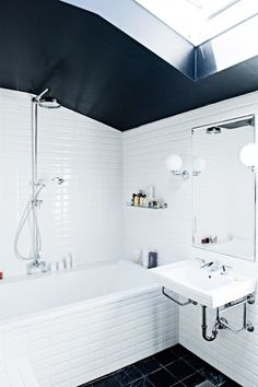 Bathroom. Wood floors, bright walls and black ceiling.