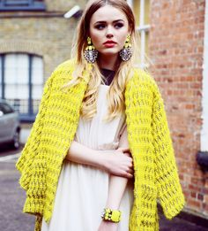 yellow coat with earrings kristina bazan