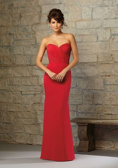 Elegant Chiffon Bridesmaid Dress with Matching Tie Designed by Madeline Gardner. Zipper back. Shown in Red.