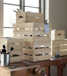 A workbench filled with storage crates in untreated solid pine.