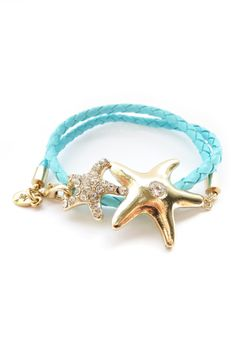 """Nordstrom Aqua Starfish Wrap Bracelet $92.00  - 24K gold dipped starfish charms with crystal accents on aqua faux leather braided bracelet - Lobster clasp - Approx. 2.25"""" inner diameter - Approx. 1.5"""" L x 1.25"""" W large starfish - Approx. 1"""" L x 1"""" W small starfish - Made in USA Materials  24K gold dipped brass, faux leather, crystal"""