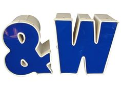 "Large 8 3/4"" Industrial Box Letters from Lighted Sign.  This is a pair of vintage sign letters from a sign that was lighted. The letters include the ""W"" and ""&"" sign and are blue with a white border. The box and border is metal and the blue is plastic. Each letter is 8 3/4"" tall and 5 1/2"" deep. These would really stand out on a wall.  Condition: The letters are used and have some wear but nothing out of the ordinary. They are not electrified so if you want them to light up you will need to…"