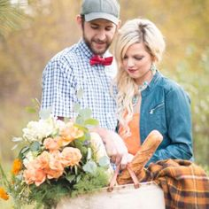 An adorable farmers market themed engagement session in a country field full of colorful flowers!