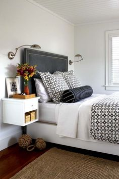 sconces + charcoal headboard, the built tables are what I had in mind w/ a basket underneath.