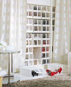 Curtains make it cozy. Stacks of SKUBB shoe box behind NINNI RUND curtains.