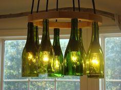 Items similar to Wine Bottle Chandelier on Etsy How To Make A Chandelier, Diy Chandelier, Lighted Wine Bottles, Bottle Lights, Glass Bottles, Habitat For Humanity, Wine Bottle Chandelier, Solar Licht, Glass Blocks