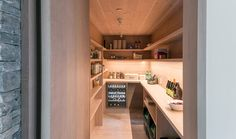 This large wood pantry has plenty of built-in shelves, counter space and a wine fridge.