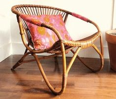 rattan chair and a vintage pillow