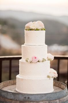 Simple multi-tiered wedding cake with pretty roses #wedding #weddingcake #cake #white #roses