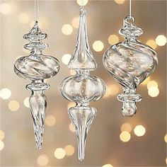 Clear blown-glass elongates in optically intriguing, light-reflecting finial ornaments, available in three different shapes and sizes. HandcraftedGlassMade in China. Classic Christmas Decorations, Elegant Christmas, Gold Christmas, Xmas Decorations, All Things Christmas, Christmas Holidays, Merry Christmas, Silver Ornaments, Christmas Tree Ornaments