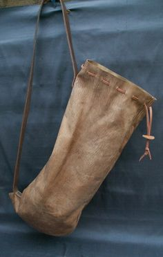 Sausage Bag This style of bag is seen in a number of illustrations from the 14th to the 17th century. They are made from vegetable tanned goat skins that have been dyed using period dyes and are made entirely by hand. They measure 25 x 10 inches (64 x 25 cms) when open.