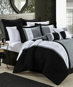 This sophisticated set brings a sense of classic style to bedroom décor. With exquisitely embroidered details alongside a palette of calming hues, this comforter set is sure to create a cozy bedroom atmosphere ready for rest and relaxation.
