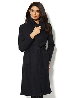 Updated classic black wool coat. Gently fitted in a soft wool ...
