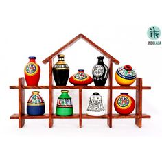 Name : Hut Shaped Frame Unit with Nine Elegant Pots Price : Rs 1,899/- Buy Now at : http://www.indikala.com/hut-shaped-frame-unit-with-nine-elegant-pots.html #Handmade #Handicraft #Pots