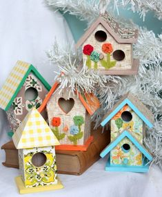 embellished birdhouses made from wallpaper scraps