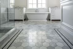 Large Marble Hex Tiles With Two Thin Black Stripes To Frame The Edges By